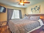 This bedroom features a king-size bed and flat screen TV.