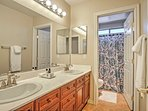 Complete nightly bedtime routines in this full bathroom with double vanity sinks