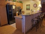 Remodeled Kitchen & Bar with Granite counters, newer appliances and swiveling barstools