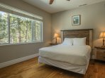 Guest Bedroom 2 is located on the main living level and features a queen bed.