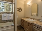 Guest Bathroom #2 on the second floor (main level) features a jetted tub/shower combination