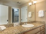 The Guest House bathroom has granite countertops and natural wood cabinetry, giving it the 'Tahoe feel' that the Black...