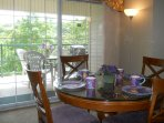 Great room opens to private covered balcony with table, chairs and gas grill.