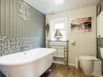 Fabulously fitted bathroom with feature vintage-style roll topped bath