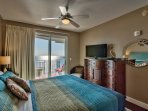 This bedroom features a flat screen TV and balcony access!