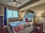 This bedroom features a queen-sized bed and flat screen TV.