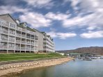 Elevate your lake getaway when you stay at this 2-bedroom, 2-bathroom vacation rental condo on the water!