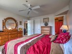 This second bedroom features a king-sized bed and beautiful wooden dressers.