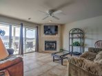 Sliding glass doors allow natural light to flow throughout the condo!