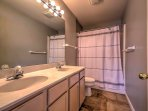 You'll  feel refreshed and energized for the day after a shower in this en-suite bathroom.