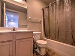 Get ready for the day in this full bathroom with shower/tub.