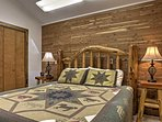 Wood paneled walls help to give this room a classic, cabin feel.