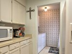 This 4th bedroom features a kitchenette with fridge and microwave.
