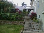 Steps to 3rd floor split level apartment, barbeque and  terraced gardens
