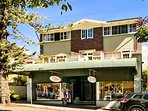 Heritage listed art deco security building, with boutique shops,in conservation area shaded by trees