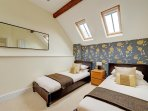 Twin bedroom, beds are made up for guests arrival.