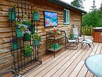 Private, south facing deck with water & sunset views, hot tub and outdoor shower.