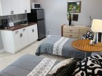 Guest house with 2 twins, galley kitchen, desk and private bath.