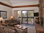 Vaulted Ceilings, Sleeper Sofa & Wood Fireplace in the Living Room