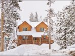 Exterior View of this New & Large Cabin Nestled in Woods