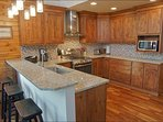 Large Kitchen features a Gas Range, Granite and Stainless Steel