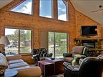 The Living & Dining Room has soaring vaulted ceilings
