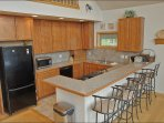 Large Kitchen with Gas Range and beautiful Cabinets