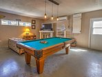 The game room offers a pool table, a foosball table, and a 50-inch flat plasma screen TV with DVD player.