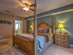 Get a good night's sleep in this plush master bedroom suite.