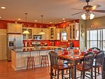 Grab a seat at the kitchen table with seating for 6 and bar top seating for 4.