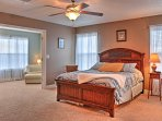 This spacious master bedroom features a queen-sized bed, reading nook, and en-suite bathroom.