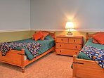 Perfect for kids, this room has 2 twin-sized beds.