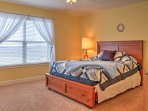 This quaint room has a queen-bed with beautiful quilted bedding.