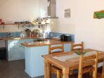 Kitchen - hand built with oak worktop and plenty of facilities ideal for 6 guests self-catering.