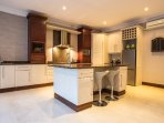 Large fully equipped kitchen with Nespresso machine and juice maker.