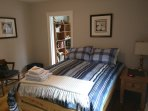 Luxurious double bed. Adjoining den with chaise lounge and a view of the Ottawa River.