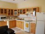 The 1BR ground floor has its own private kitchen!