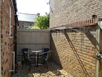 Sunny rear courtyard for relaxing/drying washing!