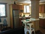 4 burner stove/oven, full sized fridge, microwave, coffee maker, toaster, eating/cooking utensils