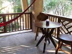 Screened-in porch w/ table, chairs, hammocks