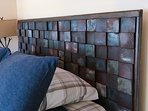 View of custom designed and created queen headboard.