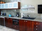 Beautiful mahogany kitchen with everything you need to have a comfortable stay.