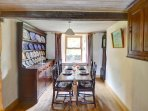 The formal dining room, open to the kitchen, has a substantial Welsh dresser, and traditional dark oak dining table and...