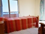 Single room showered by sun light, with two sea view balconies!