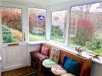 Relax in the sunny sunroom