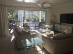 Front room with fully retractable glass doors overlooking the screened in pool and lanai.