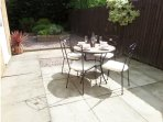 Enclosed private garden area with table and chairs for 'al fresco' dining
