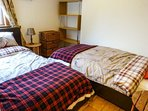 Twin bedroom with two single beds - outlook to back