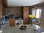 Rangemaster stove and integrated appliances with granite work tops and breakfast bar