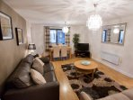 The spacious lounge comfortably accommodates up to six people and has views over the river Tyne